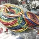 Photo of a small bag of rubber bands for Tattoo Machines.