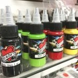 Photo of bottles of Mom's Tattoo Ink in Various colors.