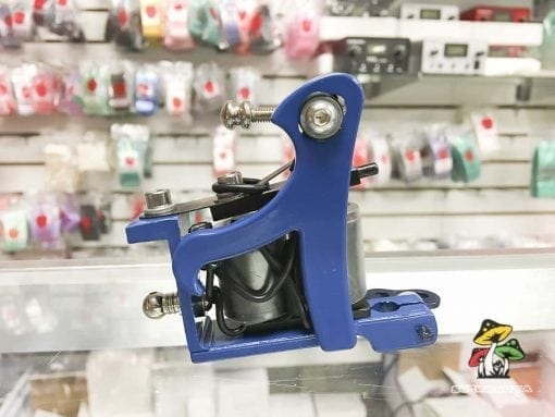 Photo of a blue tattoo machine.